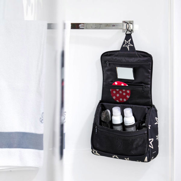 Reisenthel Stars Extra Large Toilet Bag filled with toiletries and hanging up